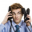 Stock Photo: Answering multiple calls at the same time