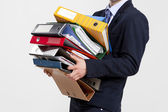 Business man carrying folders — Stock Photo