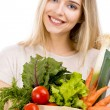 Beautiful woman carrying vegetables — Stock Photo #35279759