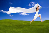 Jumping with a white tissue — Stock Photo