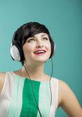 Girl listen music — Stock Photo