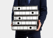 Business man with folders — Stock Photo