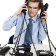 Stock Photo: Answering multiple calls at same time