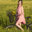 Beautiful woman with her bicycle — Stock Photo