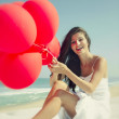 Girl with red ballons — Stock Photo #41317887