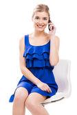 Beautiful woman talking by phone — Stock Photo