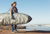 Teenage girl with  surfboard — Stock Photo