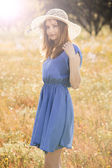 Beautiful girl on a blue dress — Stockfoto