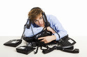 Wrapped in telephones — Stock Photo