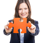 Business woman holding a puzzle piece — Stock Photo