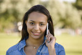 Beautiful woman talking at phone — Stock Photo