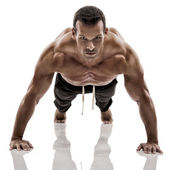 Muscle man making pushups — Stock Photo
