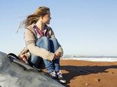 Teenage surfer girl on beach — Stock Photo