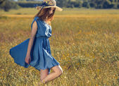 Beautiful girl on a blue dress — Stock Photo