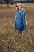 Beautiful girl on a blue dress — Stok fotoğraf