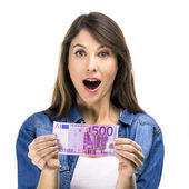Woman holding Euro — Stock Photo
