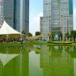 Stock Photo: Reflection of skyscrapers and tent over lake