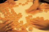 Playing mahjong — Stock Photo