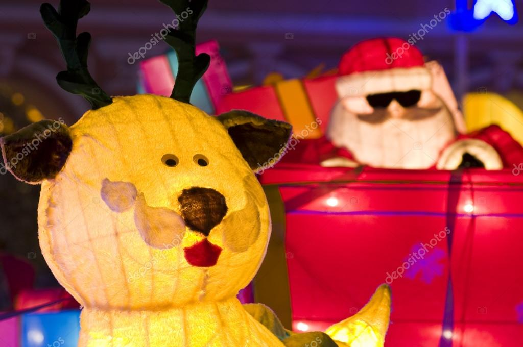 The Christmas ornaments of Santa Claus and dear — Stock Photo #20129683