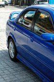 Rear view of blue sportive car — Stock Photo
