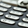 A close up shot of mobile keypad under light — Stock Photo