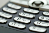 A close up shot of mobile keypad under light — Stok fotoğraf