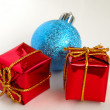 Gift boxes and christmas bulb — Stock Photo