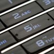 Close up shot of mobile keypad under light — Stock Photo