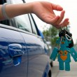Holding car key — Stock Photo