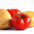Two potatoes and two tomatoes (1) — Stock Photo