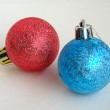 Red and blue christmas bulbs — Stock Photo