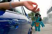 Holding car key — Stock Photo