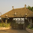 Gated entrance with thatch roof — Stock Photo