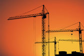 Cranes on building for construction industry — Vector de stock