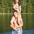 Happy couple in lake — Stock Photo