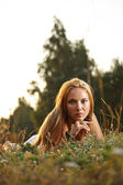 Woman laying on a meadow — Stock Photo