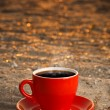 Red cup with coffee - Stock Photo
