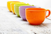 Row of color tea cups — Foto de Stock