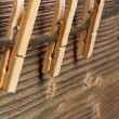 Three clothespins on rope — Stock Photo