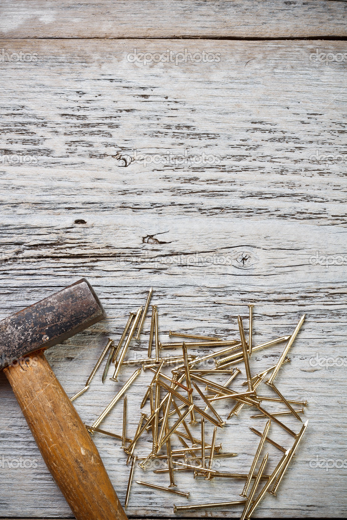 Hammer and nails on wood background — Stock Photo #13590187