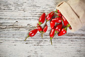 Chili peppers in tasche — Stockfoto