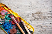 Paint box and paint brush — Stock Photo