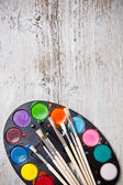 Paint and brushes — Stok fotoğraf