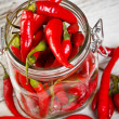 Glass jar with red chili peppers — Stock Photo #13725633