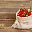 Chilli peppers in bag — Stock Photo
