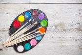 Watercolors and brushes — Stok fotoğraf