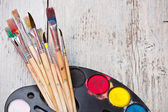 Watercolor paint with brush — Stock Photo