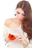 Woman tearing flower petal — Stock Photo