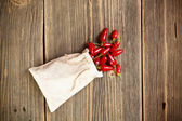 Red chilli peppers in bag — Stock Photo