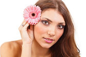 Young woman with flowers — Stock Photo